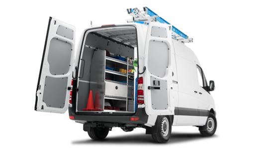 Image of an upfitted Sprinter van with back doors open.