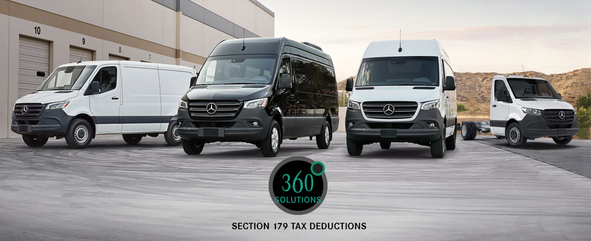 Photo of four different Mercedes-Benz van models parked at a business center.