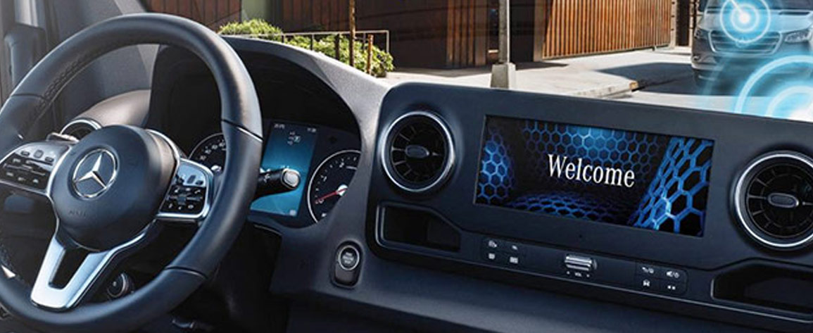 Photo of van digital center console display with welcome screen.